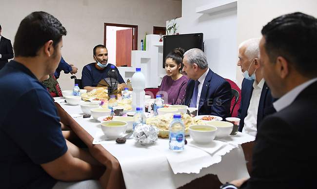 Palestinian Prime Minister Mohammad Ishtayeh, attends Ramadan break fast with the family of Mahmoud Qatoush, in the West Bank city of Ramallah on May 2, 2021. Photo by Prime Minister Office