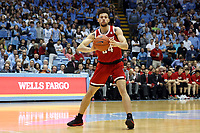 CHAPEL HILL, NC - FEBRUARY 25: Devon Daniels #24 of North Carolina State University passes the ball during a game between NC State and North Carolina at Dean E. Smith Center on February 25, 2020 in Chapel Hill, North Carolina.
