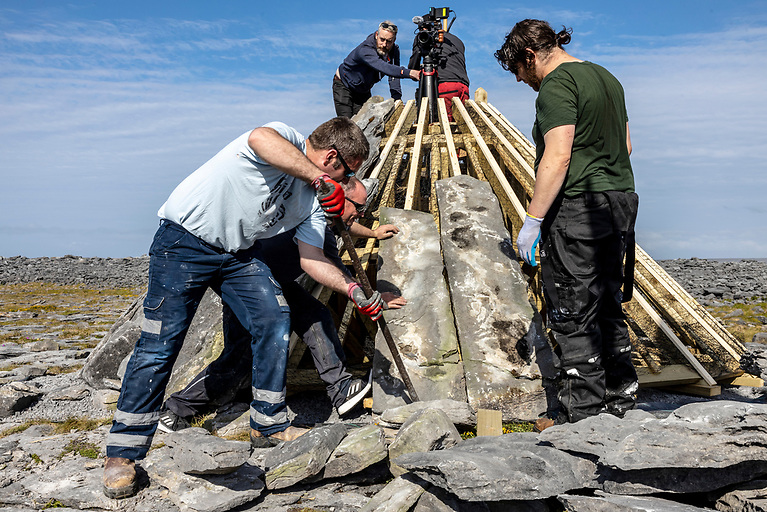 Working on the Beckett mound at Inis Oírr.  The exhibition celebrates the making and sculpting of the set, the translation process and the engagement with the community