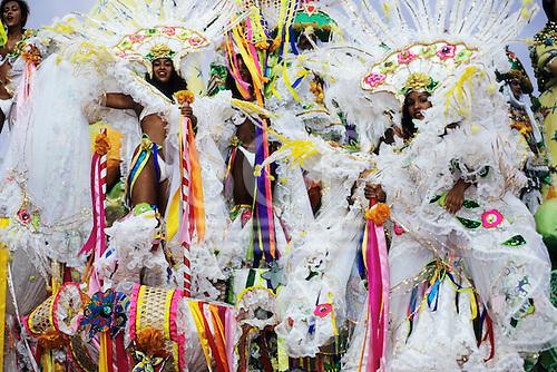 Rio de Janeiro, Brazil. Carnival, Samba school; girls in white and multicoloured bikini costumes on a float.