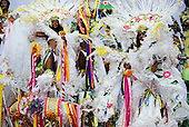 Rio de Janeiro, Brazil. Carnival, Samba school; girls in white and multicoloured bikini costumes on a float.
