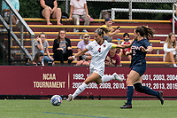 NEWTON, MA - AUGUST 29: Jenna Bike #4 of Boston College crosses the ball during a game between University of Connecticut and Boston College at Newton Campus Soccer Field on August 29, 2021 in Newton, Massachusetts.