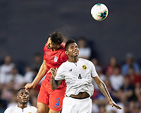 KANSAS CITY, KS - JUNE 26: Omar Gonzalez #3 and Fidel Escobar #4 challenge for a header during a game between Panama and USMNT at Children's Mercy Park on June 26, 2019 in Kansas City, Kansas.