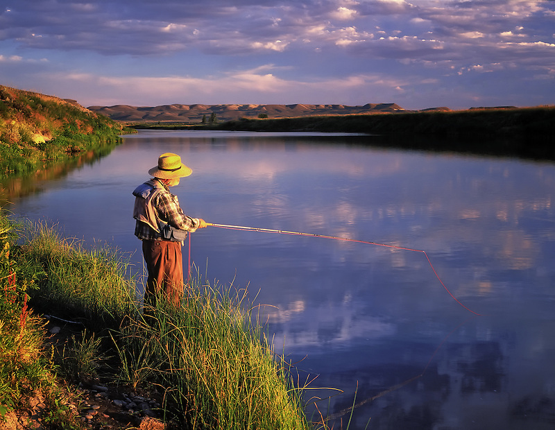 H00126M.tiff   Fly fisherman on banks of Owyhee River witrh reflection. Near Rome, Oregon