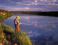 H00126M.tiff   Fly fisherman on banks of Owyhee River witrh reflection. Near Rome, Oregon