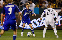 LA Galaxy midfielder David Beckham (23) defends against Kansas City Wizards defender Michael Harrington (2) as Wizard midfielder  Sacha Victorine (9) looks on during a MLS match. The LA Galaxy defeated the Kansas City Wizards 3-1 at Home Depot Center stadium in Carson, Calif., on Saturday, May 24, 2008.