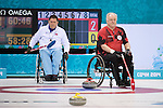 Sochi, RUSSIA - Mar 10 2014 -  Jim Armstrong calls a shot Canada vs Norway in Wheelchair Curling round robin play at the 2014 Paralympic Winter Games in Sochi, Russia.  (Photo: Matthew Murnaghan/Canadian Paralympic Committee)