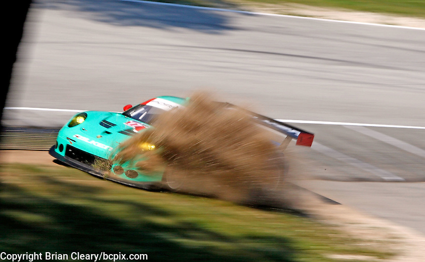 #17 Porsche of Wolf Henzler and Bryan Sellers runs off track} during practice, IMSA Tudor Series Race, Road America, Elkhart Lake, WI, August 2014.  (Photo by Brian Cleary/ www.bcpix.com )