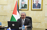 Palestinian Prime Minister Mohammad Ishtayeh, speaks during the Ministerial Conference of the Organization for Economic Cooperation and Development, in the West Bank city of Ramallah, on April 1, 2021. Photo by Prime Minister Office