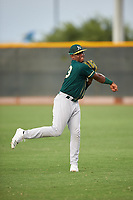 AZL Athletics Green right fielder Jorge Romero (23) warms up between innings of an Arizona League game against the AZL Reds on July 21, 2019 at the Cincinnati Reds Spring Training Complex in Goodyear, Arizona. The AZL Reds defeated the AZL Athletics Green 8-6. (Zachary Lucy/Four Seam Images)