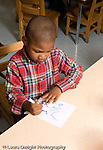 Preschool ages 3-5 art activity boy drawing letters with marker fist grip grasp vertical