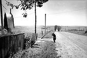 Kulekovka, Ukraine.August 1998.Praying to a roadside cross near the.Romanian border..