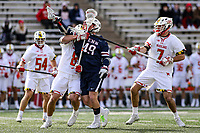 College Park, MD - February 15, 2020: Penn Quakers Kyle Gallagher (49) gets held by Maryland Terrapins midfielder Roman Puglise (8) during the game between Penn and Maryland at  Capital One Field at Maryland Stadium in College Park, MD.  (Photo by Elliott Brown/Media Images International)