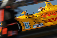 12-15 March 2008, Sebring, Florida, USA.Patrick Long flashes past a photographer in the Penske run DHL Porsche RS Spyder #6 during practice for the Sebring 12 Hours..©F.Peirce Williams 2008, USA .