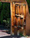 Wooden door, entry to the famous Santuario (chapel) known for its healing powers, Chimayo, New Mexico