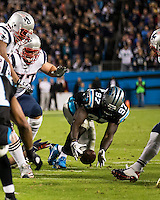 The Carolina Panthers play the New England Patriots at Bank of America Stadium in Charlotte North Carolina on Monday Night Football.  The Panthers defeated the Patriots 24-20.  Carolina Panthers defensive end Mario Addison (97) recovers a fumble by New England Patriots running back Stevan Ridley (22)