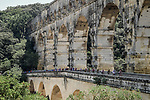 The peloton pass beneath le Pont du Gard during Stage 16 of the 2019 Tour de France running 177km from Nimes to Nimes, France. 23rd July 2019.<br /> Picture: ASO/Pauline Ballet   Cyclefile<br /> All photos usage must carry mandatory copyright credit (© Cyclefile   ASO/Pauline Ballet)