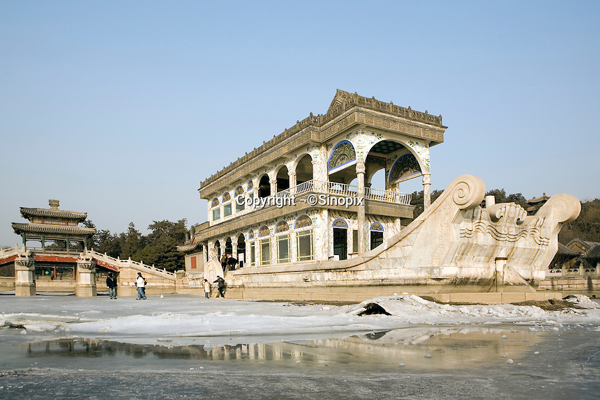 The Marble Boat on Kunming Lake at the Summer Palace..The Summer Palace, a palace 15km from Beijing, is mainly dominated by Longevity Hill (60 meters high) and Kunming Lake. It covers an expanse of 2.9 square kilometers, three quarters of which is water..Beijing..Dec 2005