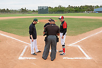 Edgewood Eagles head coach Al Brisack during the lineup exchange with Adam Skonieczki (left) before a game against the South Vermont Mountaineers on March 18, 2019 at Lee County Player Development Complex in Fort Myers, Florida.  South Vermont defeated Edgewood 19-6.  (Mike Janes/Four Seam Images)
