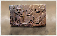 Picture of Neo-Hittite orthostat describing the legend of Gilgamesh from Karkamis,, Turkey. Museum of Anatolian Civilisations, Ankara. Mythological scene. The 2 figures in the center are flanked by lion headed men who have one fist outstretched and are known as Ugallu. The 2 figures in the middle holding spears are men with bodies of bulls known as Kusarikku. 2