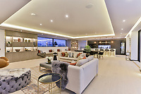 BNPS.co.uk (01202) 558833<br /> Pic: Savills/BNPS<br /> <br /> The home has over 7,000 sq ft of living space over two floors.<br /> <br /> A striking high-tech eco home that would not look out of place in a Bond film is on the market for offers over £4m.<br /> <br /> Skyfall is a luxurious house in the Berkshire countryside designed to be totally carbon free.<br /> <br /> With its luxe white interiors, minimalist decor and stunning countryside surroundings, the five-bedroom property would fit effortlessly into 007's world.<br /> <br /> But it's the eco features of the brand new house, which is just outside the village of Taplow with Huntswood Golf Course next door, that make it really stand out.