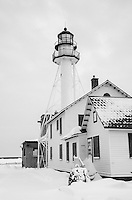 A winter view of the Whitefish Point Lighthouse near Paradise, MI