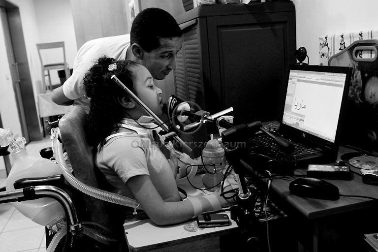 Mariya Aman works on a special computer helped by her father Hamdi in Alyn, a rehabilitation hospital in Jerusalem, October 12,2007..Photo by Quique Kierszenbaum...