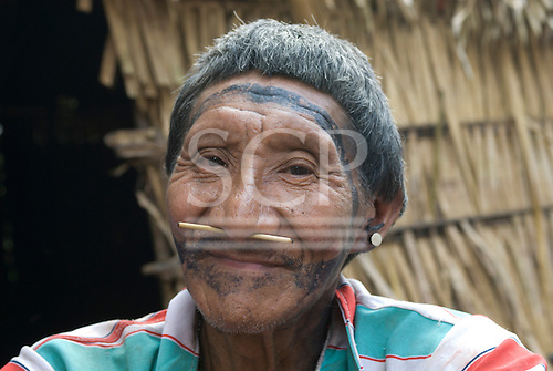 Xingu, Pará State, Brazil. Aldeia Laranjal (Arara). Cacique Toití Arara. with nose sticks and ear plugs.