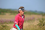 Current leader Bernhard Langer of Germany walks away from the 13th tee during day one of The Senior Open Golf Tournament at The Royal Porthcawl Golf Club in South Wales this afternoon.