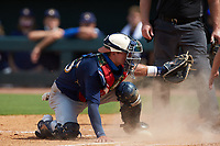 Catcher Treyton Rank (25) of Buford HS in Dacula, GA playing for the Milwaukee Brewers scout team makes a tag attempt at home plate during the East Coast Pro Showcase at the Hoover Met Complex on August 2, 2020 in Hoover, AL. (Brian Westerholt/Four Seam Images)