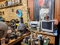 BNPS.co.uk (01202 558833)<br /> Pic: AdamPartridgeAuctioneers/BNPS<br /> <br /> Pictured: Part of the living room <br /> <br /> A huge collection of pottery and ceramics found stacked inside the suburban home of an elderly couple has sold for almost £200,000.<br /> <br /> Leonard and Alison Shurz filled every room of their three bed house with ceramic pieces they had gathered from all over the world.<br /> <br /> The Aladdin's Cave of pots, bowls, plates, vases and jugs was found by a stunned auctioneer who had the daunting task of cataloguing it all.