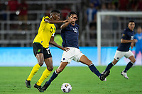 ORLANDO, FL - JULY 20: Damion Lowe #17 of Jamaica and Bryan Ruiz #10 of Costa Rica battle for the ball during a game between Costa Rica and Jamaica at Exploria Stadium on July 20, 2021 in Orlando, Florida.