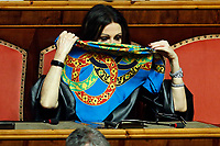 Senator Daniela Santanche' wearing a scarf as a mask<br /> Rome March 26th 2020. Senate. Information of the Italian Premier about the measures adopted to contrast Coronavirus, Covid-19.<br /> Photo Samantha Zucchi Insidefoto