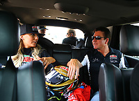 Apr 22, 2017; Baytown, TX, USA; NHRA top fuel driver Leah Pritchett (left) talks with Papa Johns Pizza founder John Schnatter in her tow vehicle after making a qualifying run for the Springnationals at Royal Purple Raceway. Papa John and Pritchett will face off in a Charity Challenge at the NHRA Four Wide Nationals in Charlotte. Mandatory Credit: Mark J. Rebilas-USA TODAY Sports