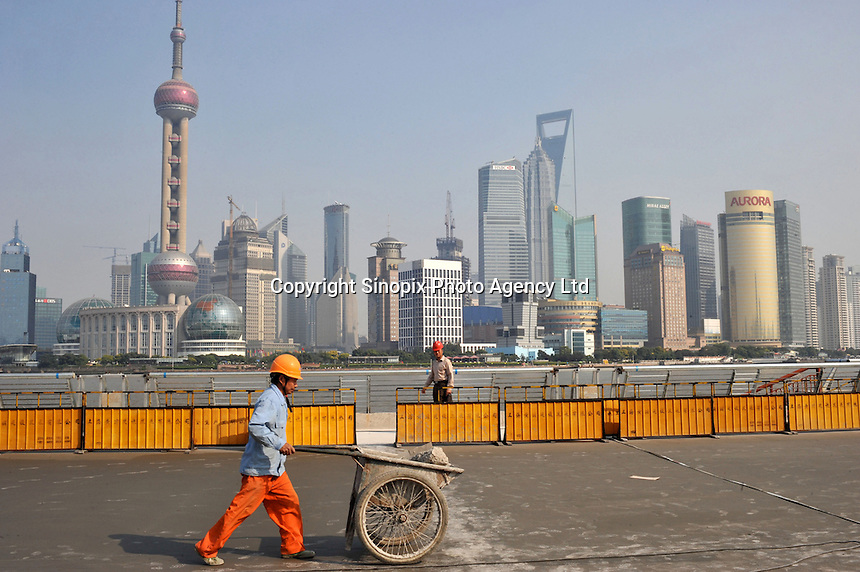 """The Shanghai Bund is under going a face-lift for the 2010 Shanghai Expo. The theme of Expo 2010 is """"Better City, Better Life,"""" representing the common wish of the whole humankind for a better living in future urban environments.."""