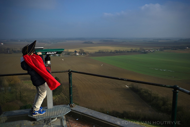 A boy dressed like Emperor Napoleon Bonaparte looks through binoculars over the Waterloo battlefield from on top of the Lion's Mound in Waterloo, Belgium on Feb. 17, 2013. Napoleon's historic loss to the the Duke of Wellington in 1815 meant the surrounding territory would not be part of France. Instead, a buffer state comprised of French and Dutch-speakers emerged into present-day Belgium.