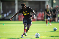 LAKE BUENA VISTA, FL - JULY 14: C.J. Sapong #9 of the Chicago Fire kicking on the ball during a game between Seattle Sounders FC and Chicago Fire at Wide World of Sports on July 14, 2020 in Lake Buena Vista, Florida.