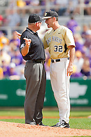 Wake Forest Demon Deacons head coach Tom Walter #32 argues a balk call with first base umpire Paul Guillie during the game against the LSU Tigers at Alex Box Stadium on February 20, 2011 in Baton Rouge, Louisiana.  The Tigers defeated the Demon Deacons 9-1.  Photo by Brian Westerholt / Four Seam Images