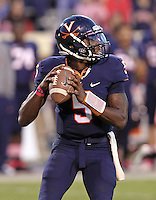 Oct. 22, 2011 - Charlottesville, Virginia - USA; Virginia Cavaliers quarterback David Watford (5) handles the ball during an NCAA football game against the North Carolina State Wolfpack at the Scott Stadium. NC State defeated Virginia 28-14. (Credit Image: © Andrew Shurtleff/