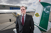 Aviation Technology Division's new Director, Paul Herrick, photographed with a Seawolf Cessna 180 at Merril Field outside UAA's Aviation Technology Building.