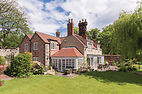 BNPS.co.uk (01202) 558833. <br /> Pic: SandersonYoung/BNPS<br /> <br /> The house.<br /> <br /> A quirky 'show home' for a brickwork owner where Lewis Carroll is believed to have stayed while writing some of his Alice in Wonderland books is on the market for just under £1m.<br /> <br /> Red Cottage is a striking Grade II listed property in Whitburn, Tyne and Wear, where Charles Dodgson, otherwise known as Lewis Carroll, regularly visited family.<br /> <br /> The unusual 179-year-old home was built to show off as many design features as possible, and has a walled garden and even an air raid shelter.