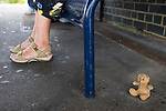 """Folkestone Triennial public art exhibition. Kent UK 2008. Tracey Emin """"Baby Things"""". Teddy Bear at the central station under bench."""