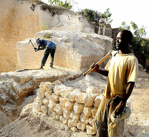 Stone Cutters of Likoni. In Likoni, Kenya men with picks toil all day in the hot sun to cut stones from a quarry.  On a good day, they can cut 30 stones.   With pay of 10 schillings each, they earn 300 schillings a day, about $3.75 a day.  Some of the men are local, others told me they traveled from 2,000 km away, because it was the only work they could find to feed their families.  The quarry was said to be one of the most dangerous places in the region, but I found the men welcoming, warm, and humble.  Several invited me to visit their homes.   They seemed proud of their physical labor, and that they were willing to work hard for their money.