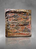 Wall fresco of geometric red and black triangles which appears to be a rug pattern copy. 6000 BC. . Catalhoyuk Collections. Museum of Anatolian Civilisations, Ankara. Against a gray mottled background