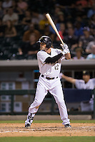 Andy Parrino (12) of the Charlotte Knights at bat against the Indianapolis Indians at BB&T BallPark on June 17, 2016 in Charlotte, North Carolina.  The Knights defeated the Indians 4-0.  (Brian Westerholt/Four Seam Images)