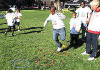 """Thomas Rongen watches a participant during a  D.C United clinic in support of first lady Michelle Obama's """"Let's Move"""" initiative on the White House lawn, in Washington D.C. on October 7 2010."""