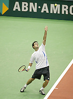 24-2-06, Netherlands, tennis, Rotterdam, ABNAMROWTT,t Daniele Bracciali in action against Nikolay Davydenko