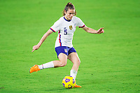 ORLANDO, FL - JANUARY 18: Kelley O'Hara #5 of the USWNT kicks the ball during a game between Colombia and USWNT at Exploria Stadium on January 18, 2021 in Orlando, Florida.