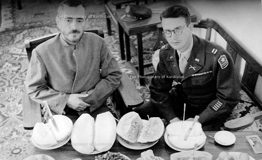 Iran 1946 .Qazi Mohammed with Captain Archibald Roosevelt, American officer,  in his house of Mahabad. .Iran 1946.Qazi Mohammed dans sa maison de Mahabad avec le capitaine Archibald Roosevelt, officier americain