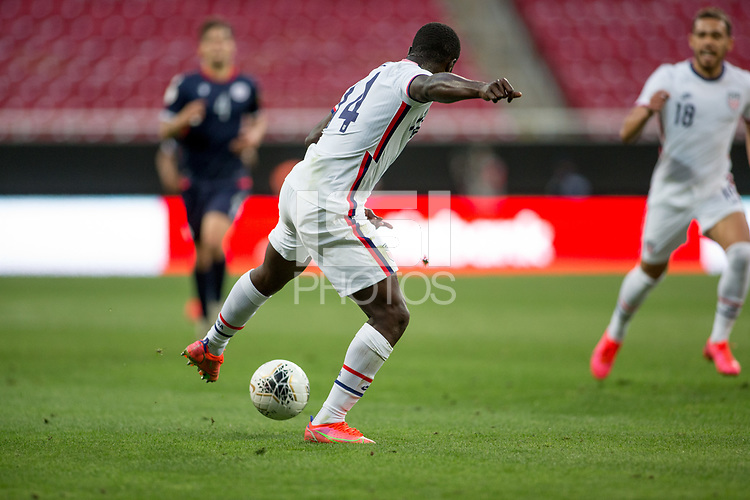 ZAPOPAN, MEXICO - MARCH 21: Benji Michel #14 of the United States turns and moves with the ball during a game between Dominican Republic and USMNT U-23 at Estadio Akron on March 21, 2021 in Zapopan, Mexico.
